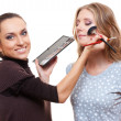 Esthetician applying eyeshadow - Stock Photo