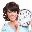Happy young woman with clock - Stock Photo