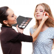 Make-up artist applying eye shadow — Stock Photo