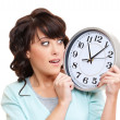 Shocked woman with clock — Stock Photo