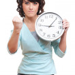 Strict young woman holding clock — Stock Photo #8800926