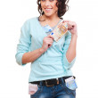 Smiley young woman holding euro in her hands — Stock Photo