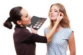 Make-up artist applying eye shadow — Stock Photo