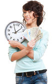 Woman holding money and clock — Stock Photo