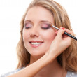 Studio shot of lovely young woman having make up — Stock Photo #9625347
