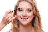 Smiley woman with professional make-up — Stock Photo