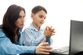 Child claping hands in front of laptop — Stock Photo