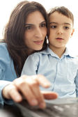Mother and son looking at monitor — Stock Photo