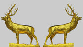 Two golden statues of the red deer — Stock Photo