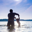Father and daughter swimming — Stock Photo