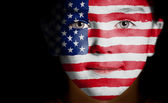 Child face painted with the flag of USA. — Foto Stock