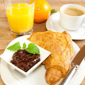 Continental breakfast with croissants — Stock Photo