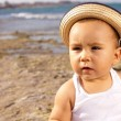 Baby with straw hat — Stock Photo