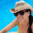 Woman relaxing at pool — Stock Photo