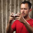 Young man with mobile phone — Foto Stock