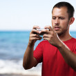 Young man with mobile — Stock Photo #10172239