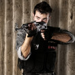Young soldier aiming — Stock Photo #10172728