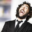 Young man laughing — Stock Photo