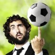 Young man with a soccer ball — Stock Photo #10173642