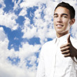 Young man with thumb up - Lizenzfreies Foto
