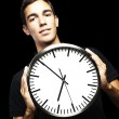 Young man and clock — Stock Photo #10175169
