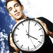 Royalty-Free Stock Photo: Man holding clock