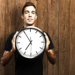 Man holding clock — Stock Photo #10175221