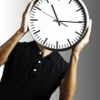 Young man with clock — Stock Photo #10175237
