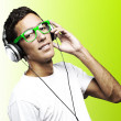 Young man listening to music — Stock Photo #10175723