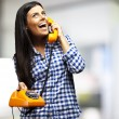 Portrait of young woman talking on vintage telephone indoor — Stock Photo #10176126