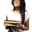 Portrait of young girl holding books over white background — Stock Photo