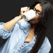 Woman drinking coffee - Stok fotoraf