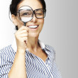 Woman with magnifying glass — Stock Photo #10177027