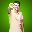 Young man gesturing — Stock Photo #10177595
