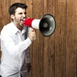 Stock Photo: Man shouting with megaphone