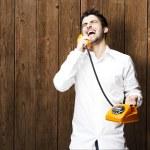 Man holding telephone — Stock Photo #10178347