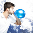 Man blowing balloon — Stock Photo #10178397