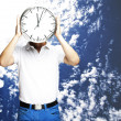 Foto Stock: Man holding clock
