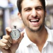 Foto Stock: Man holding stopwatch
