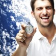 Stock Photo: Man holding stopwatch