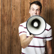 Man shouting with megaphone — Stock Photo #10178575