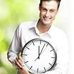Man holding clock — Stock Photo #10178894