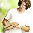 Man holding books — Stock Photo