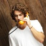 Man talking on telephone — Stock Photo #10179182