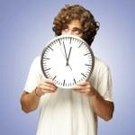 Man hidden behind clock — Stock Photo #10179312