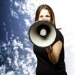 Woman with megaphone — Stock Photo
