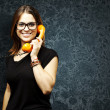 Woman using telephone — Stock Photo