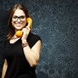 Woman using telephone — Stock Photo #10179699