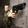 Soldier pointing - Stock Photo