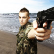 Stock Photo: Young soldier aiming
